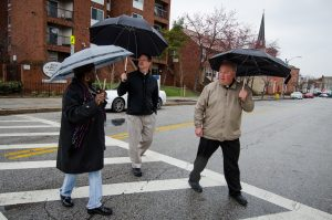 Betty Bland-Thomas, an expert in community redevelopment, leads the Rev. Steven Schave, director of LCMS Urban & Inner-City Ministry (center) and the Rev. Elliott Robertson, pastor of Martini Lutheran Church, on a walk near his church (seen in the rear) on Friday, March 28, 2014, in Baltimore, Md. LCMS Communications/Erik M. Lunsford
