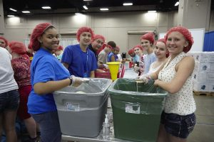 At the 2013 LCMS Youth Gathering, participants packed 323,000 meals on the floor of the convention center.