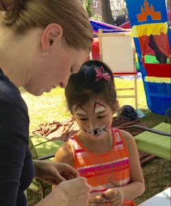 Activities for children included face painting, Bible stories, and crafts.