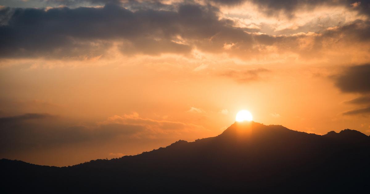 Orange sunrise over a mountaintop